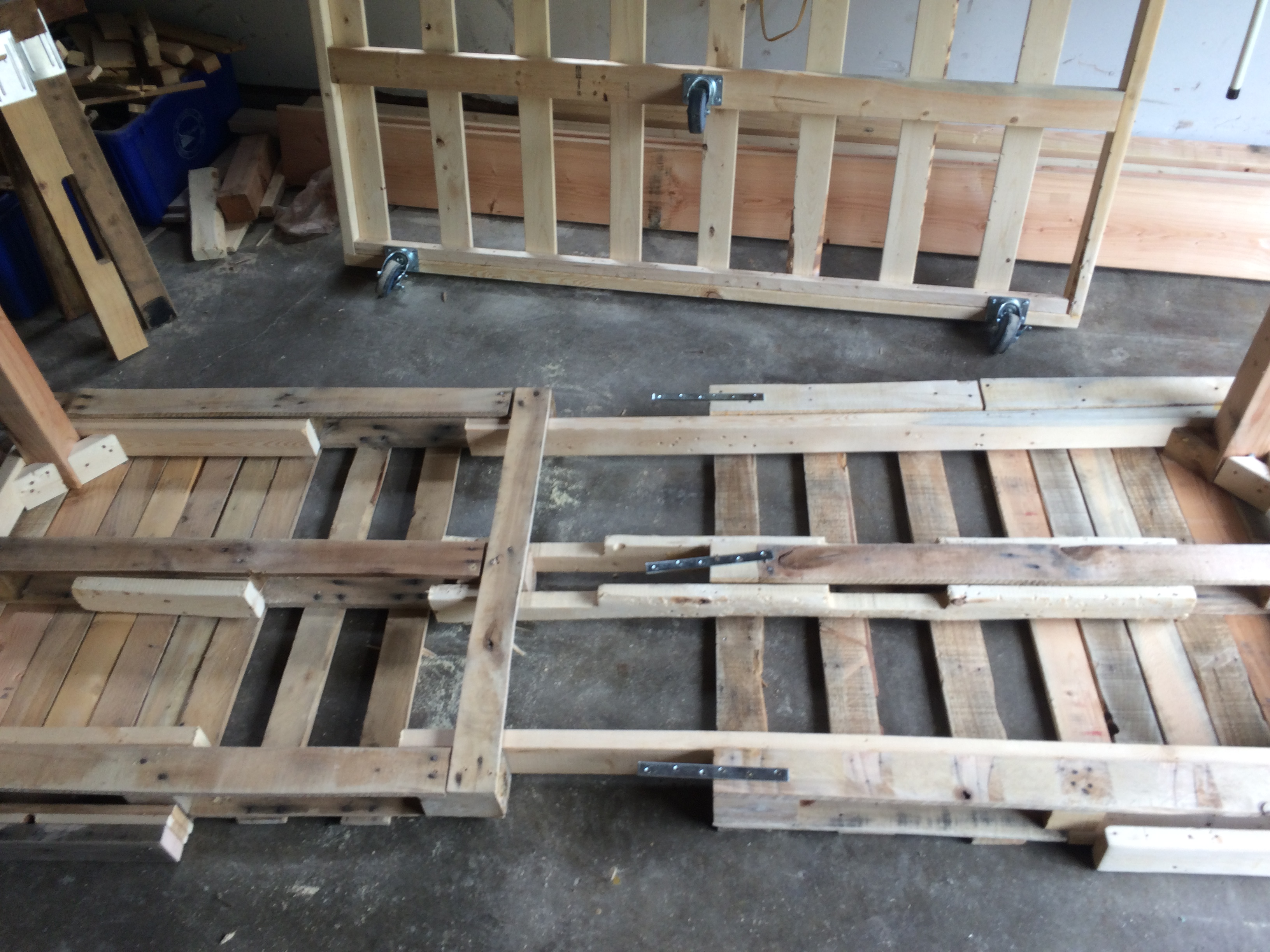 DIY Pallet Day Bed with Roll Out Trundle | SMS Designs
